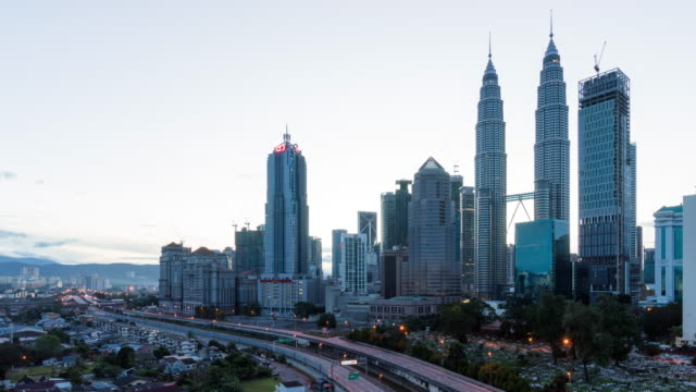 time-lapse traffic Malaysia city sun rise, panning right video 4k.