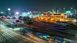 Timelapse traffic of car at front of Seoul Station with light trails of car at night in Seoul, South korea.
