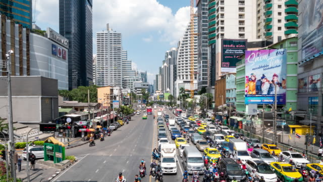 time-lapse : traffic on ratchadaphisek road at asoke intersection in bangkok city downtown thailand, 4k resolution. - shopping mall stock videos & royalty-free footage