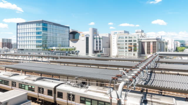 time-lapse: train transportation with himeji cityscape in hyogo kansai japan - traffic light stock videos & royalty-free footage