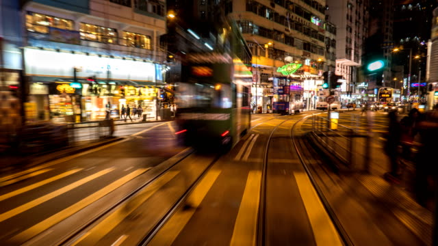 4k timelapse - tram pov of hong kong central - fast motion stock videos & royalty-free footage