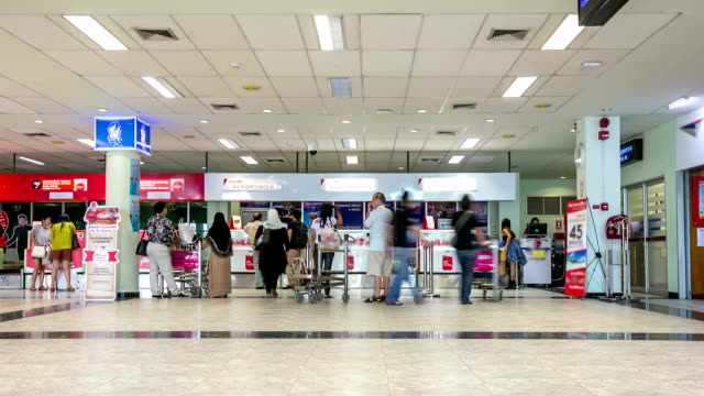 hd timelapse: traveler at airport check in counter hall - airport check in counter stock videos & royalty-free footage