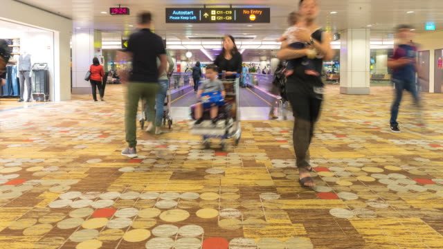 time-lapse: traveler at airport departure area in international terminal - urgency stock videos & royalty-free footage