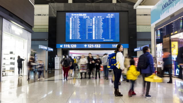 Time-lapse: Traveler at Airport Departure information board