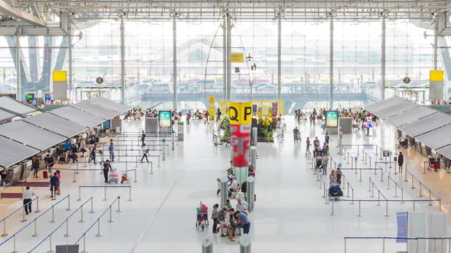 Time-Lapse: Traveler at Airport Departure Terminal