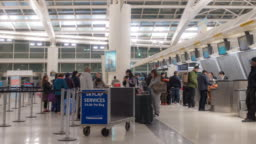 Time-lapse Traveler Crowd at Airport check in counte New York USA