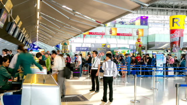 hd time-lapse: traveler crowd at airport check in counter hall - airport check in counter stock videos & royalty-free footage