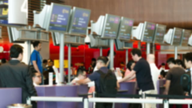 HD Time-lapse: Traveler Crowd at Airport Check In Counter Hall