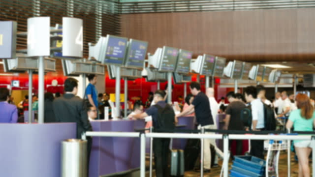 hd time-lapse: traveler crowd at airport check in counter hall - airline check in attendant stock videos and b-roll footage