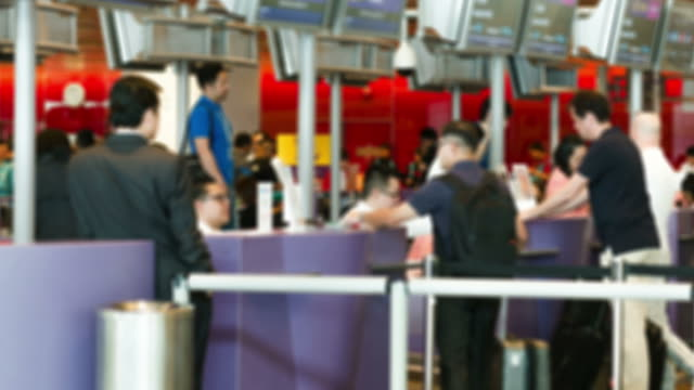 hd time-lapse: traveler crowd at airport check in counter hall - airline check in attendant stock videos & royalty-free footage