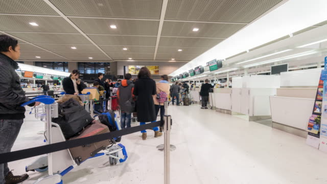 time-lapse: traveler crowd at airport check in counter hall - airport check in counter stock videos & royalty-free footage
