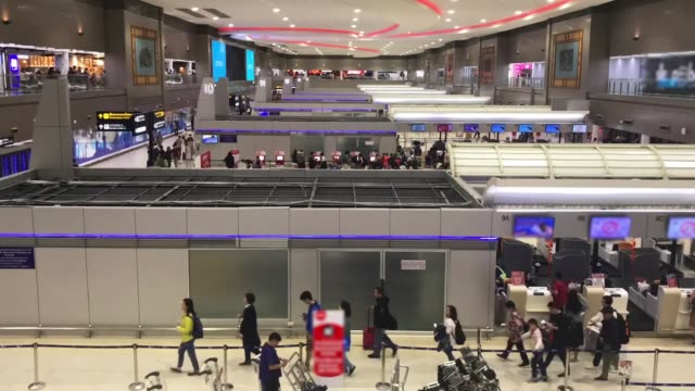 time-lapse: traveler crowd at airport check in counter hall - airline check in attendant stock videos and b-roll footage