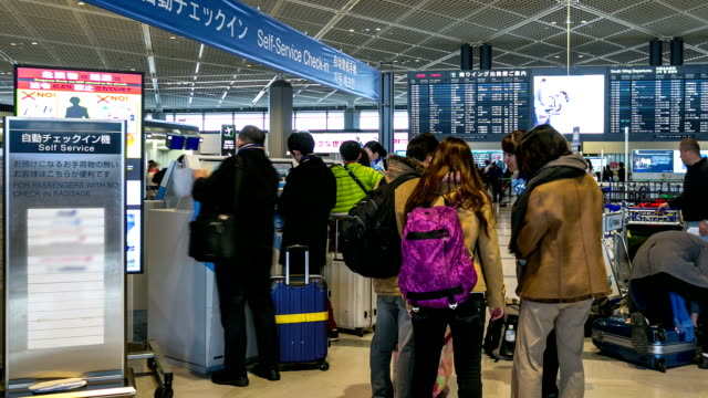 HD Time-lapse: Traveler Crowd at Airport Check-in Kiosk