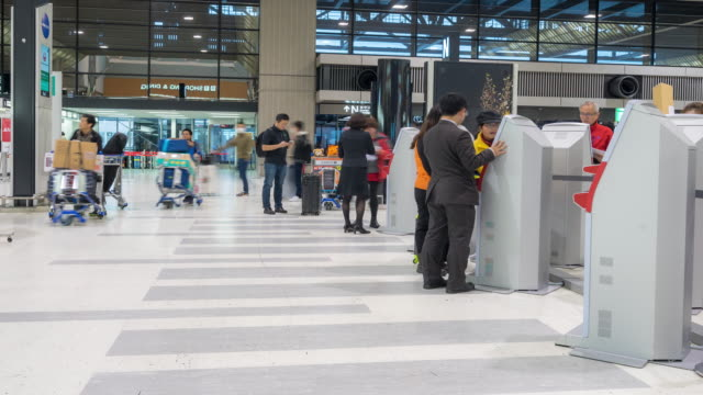 time-lapse: traveler crowd at airport check-in kiosk - booth stock videos & royalty-free footage