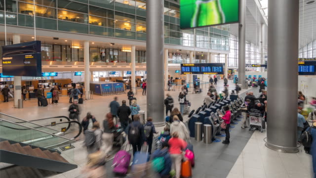 time-lapse traveler crowd at airport departure hall copenhagen denmark - passenger stock videos & royalty-free footage