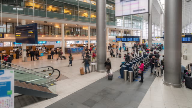 time-lapse traveler crowd at airport departure hall copenhagen denmark - blackboard stock videos and b-roll footage