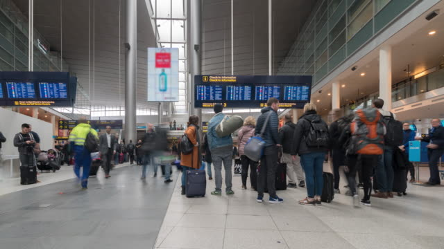 time-lapse traveler crowd at airport departure hall copenhagen denmark - crowded airport stock videos & royalty-free footage