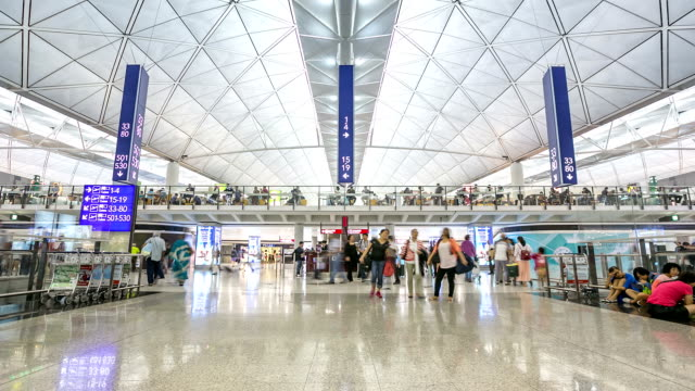hd time-lapse: traveler crowd at airport departure hall hong kong - hong kong international airport stock videos and b-roll footage