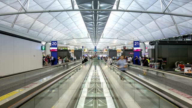 HD Time-lapse: Traveler Crowd at Airport Departure Hall Hong Kong