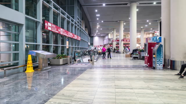time-lapse: traveler crowd at airport departure hall macau, china - airline check in attendant stock videos and b-roll footage