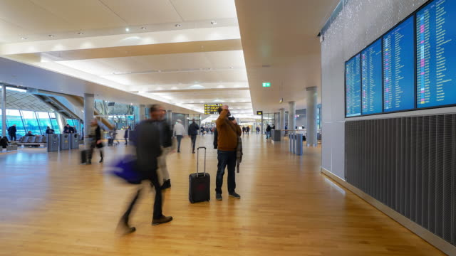 4k time-lapse traveler crowd at airport departure hall oslo norway, apple prores 422 (hq) 3840x2160 format - airline check in attendant stock videos and b-roll footage