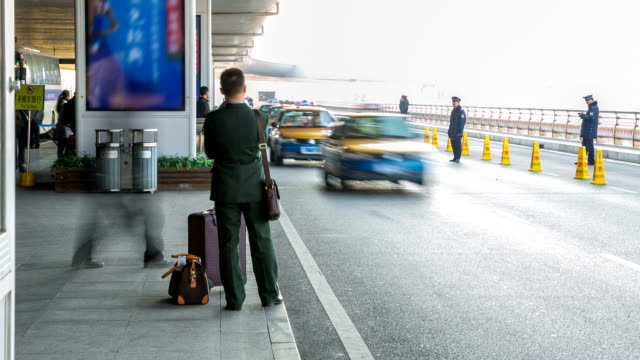 time-lapse: traveler crowd at airport taxi stand - taxi stand stock videos and b-roll footage