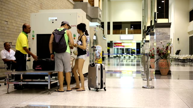 hd time-lapse: traveler crowd at airport x-ray counter - bag stock videos & royalty-free footage