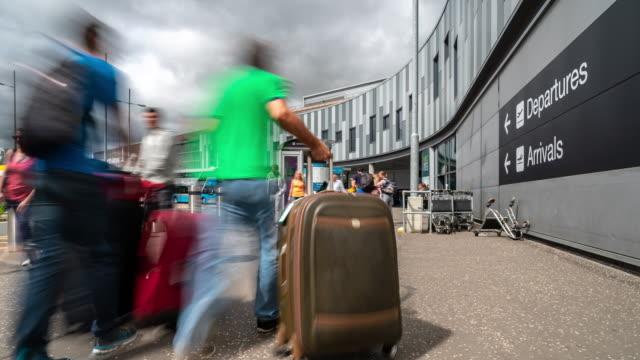Timelapse: Traveler Crowd at Edinburgh International Airport outside terminal