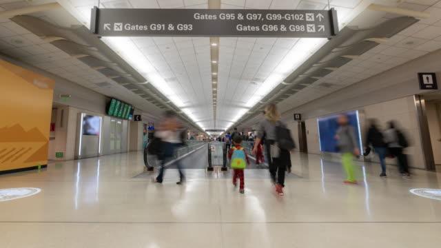 timelapse: traveler crowd at san francisco international airport departure area - san francisco international airport stock videos & royalty-free footage