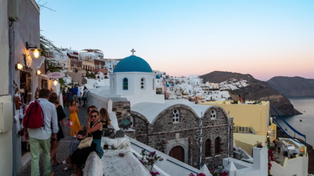 time-lapse : traveler crowd with santorini at oia city greece with sunrise, 4k resolution. - oia santorini stock videos & royalty-free footage