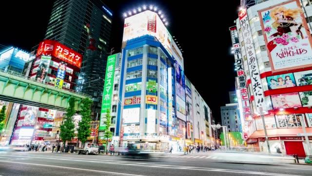 4k time-lapse: traveler pedestrian crowded walking across the crosswalk at akihabara district area, tokyo, japan. - akihabara station stock videos and b-roll footage
