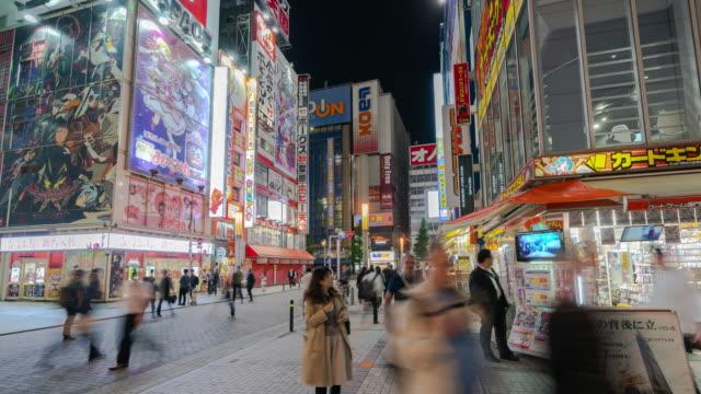 4k time-lapse: traveler pedestrian crowded walking at akihabara district area, tokyo, japan. - akihabara station stock videos and b-roll footage