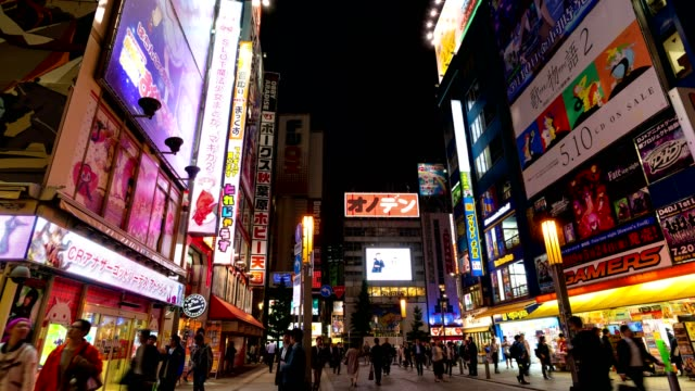 4k time-lapse: traveler pedestrian crowded walking at akihabara district area, tokyo, japan. tilt down shot - akihabara station stock videos and b-roll footage