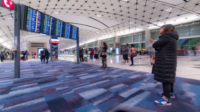 time-lapse: traveler tourist crowd at airport departure area in  hong kong - airline check in attendant stock videos and b-roll footage