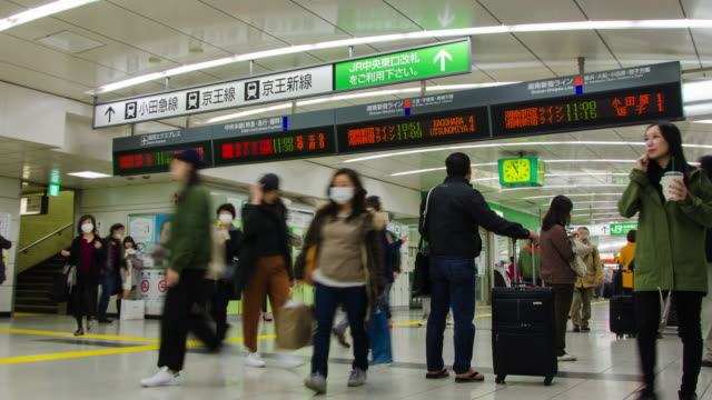4k time-lapse: traveller crowded at shinjuku railway station in tokyo , japan . - station stock videos & royalty-free footage