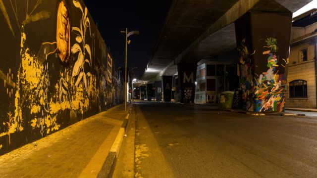 timelapse under the bridge at maboneng in the city centre of johannesburg - image stock videos & royalty-free footage