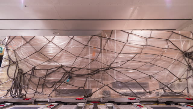 4k time-lapse: unloading cargo inside cargo aircraft - cargo aeroplane stock videos & royalty-free footage