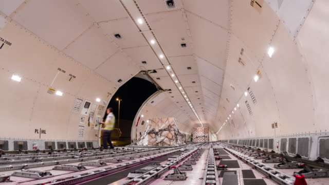 time-lapse: unloading cargo inside cargo plane - unloading stock videos & royalty-free footage