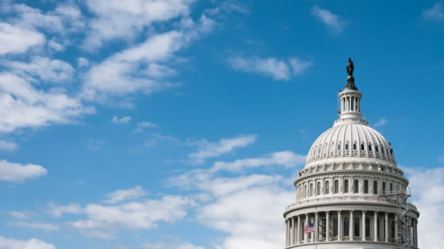 time-lapse us capitol dome (congress) and cloudy sky - flag stock videos & royalty-free footage
