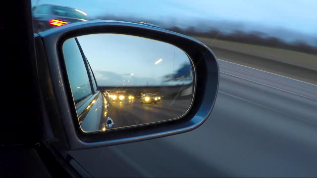 timelapse vehicle wing mirror on the motorway. dusk. - wing mirror stock videos & royalty-free footage