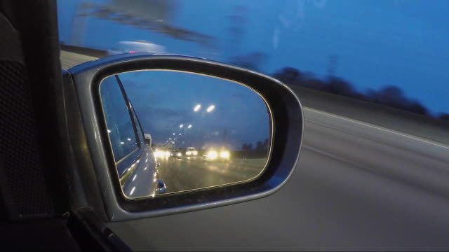 timelapse vehicle wing mirror on the motorway.dusk. - wing mirror stock videos & royalty-free footage