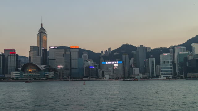 time-lapse: victoria harbour skyline during sunset twilight - victoria hong kong stock videos & royalty-free footage