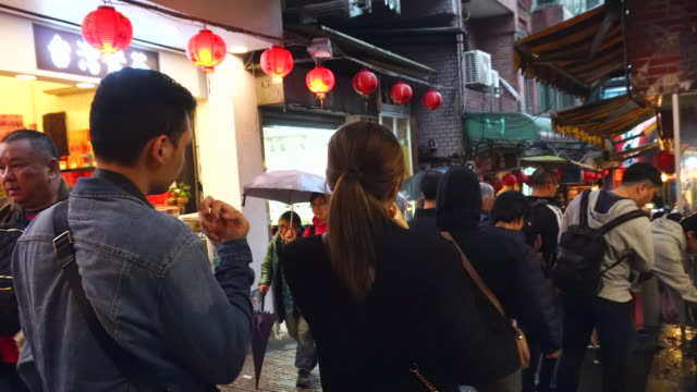 timelapse video of jioufen old street with people moving at jioufen market in taipei, tiwan - taipei stock videos & royalty-free footage