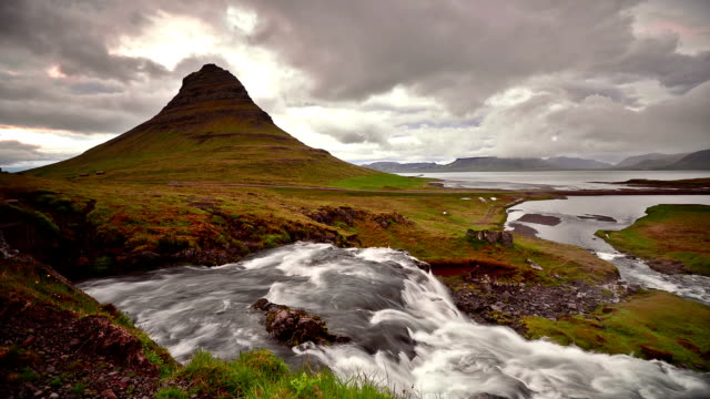 Timelapse video of Moving cloud and water at twilight, Kirkjufell,
