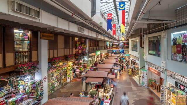 time-lapse video of people walking in the famous central market mall in downtown - malaysia stock videos & royalty-free footage