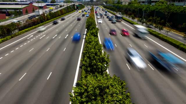 vídeos de stock e filmes b-roll de timelapse da estrada central de singapura - carrinha veículo