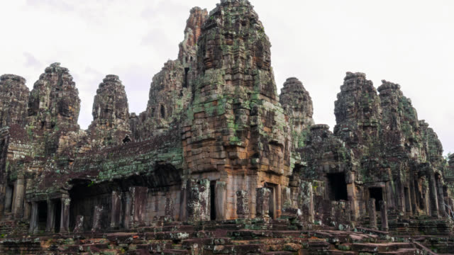 timelapse view of a bayon temple at angkor wat - angkor stock videos and b-roll footage