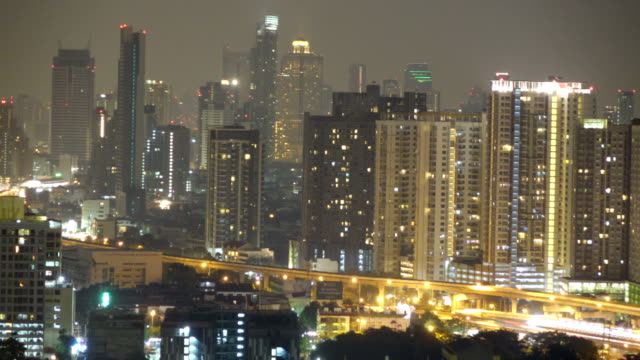 timelapse view of bangkok city at night with traffic on sathorn road - anno 1920 video stock e b–roll