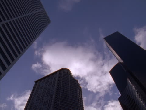 Timelapse view of clouds passing over skyscrapers