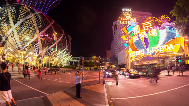 timelapse view of macau casino area - macao stock videos & royalty-free footage
